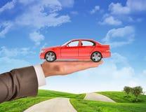 Car on businessmans hand Stock Photo