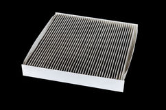 Car cabin filter. Isolated on black Stock Images
