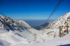Car cable lines passing over the famous Transfagarasan road, covered in snow. In Sibiu county, Romania Stock Image