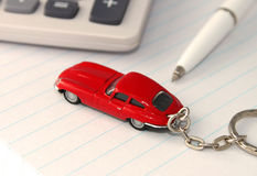 Car Calculating. A general metaphor for car finance, sale and debt Royalty Free Stock Photos