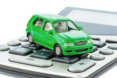 Car and calculator. A car is on a calculator. cost of gasoline, wear and insurance. car costs are not paid by commuter tax royalty free stock photo