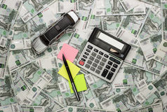 Car and calculator on money background Royalty Free Stock Photo
