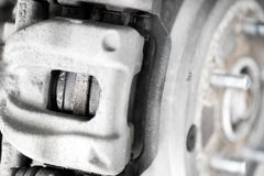 Car caliper and wheel hub close. Close up caliper and wheel hub of modern car Stock Photo