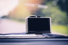 Car camera recorder with car navigator  device gps on the glass - front car DVR for safety on the road accident royalty free stock photography