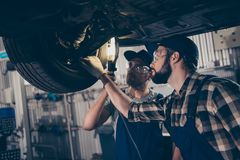 Car care, upgrading, automotive, industry, team building, team w. Ork, friends, friendship, oneness, help, colleagues professionals in special blue safety stock photography