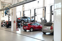 Car-care workshop. The image of car-care workshop and cars near the lifts Stock Photos
