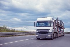 Car carrier on the highway stock photo