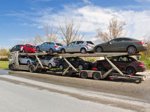 Car Carrier. A large truck carying cars Stock Photos
