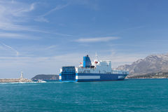 Car carrier leaves the Port Stock Image