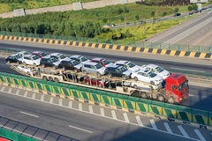 Car carrier truck. Is driving on the highway stock photo