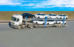Car carrier truck. On a road stock image