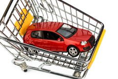 Car in cart. A car in the shopping cart as a symbol of car buying and leasing royalty free stock photos