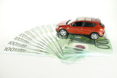 Car on cash. Car staying on euro cash isolated over white Stock Image