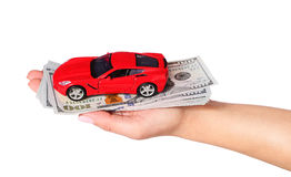 Car with cash in female hand isolated on white Royalty Free Stock Image