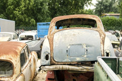 Car cemetery - old rusty english damaged cars. Car cemetery ,british rusty damaged cars Stock Images