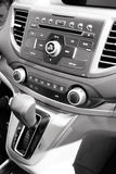 Car centerstack. Car audio and climate controls close up shot Royalty Free Stock Photo