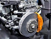 Car ceramic disc brake with yellow caliper. Stock Photos