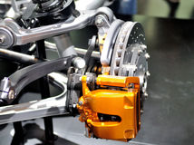 Car ceramic disc brake with yellow caliper. Stock Photography