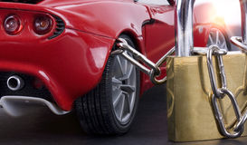 Car chained with padlock close up Royalty Free Stock Image