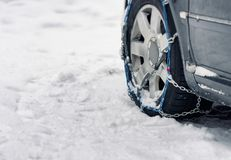 Car with chains on snow. Car with snow chains on stock photos