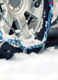 Car with chains on snow. Car with snow chains on stock photography
