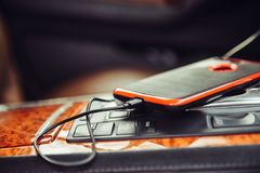 Car charger for the mobile phone. Phone charging in luxury car. Royalty Free Stock Photos