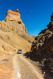 Car in Charyn Canyon Royalty Free Stock Photos