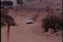 Car chase on dirt road stock video footage