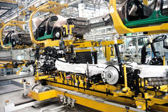 Car chassis installation. Automobile assembly shop,Car chassis installation Stock Images