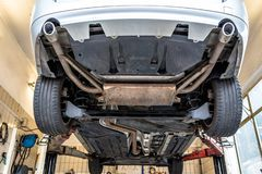 Free Car Chassis On The Lift, View From The Bottom. Visible Exhaust System, Wheels, Brake Hoses. Royalty Free Stock Photography - 143852667