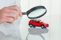 Car is checked by doctor. A model of a car is examined by a doctor. photo icon for workshop, service and car buying royalty free stock photos