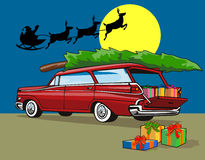 Car with Christmas tree on top Royalty Free Stock Images
