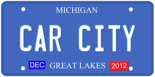 Car City Michigan. An imitation Michigan license plate with December 2012 stickers and Car City written on it making a great Detroit or Michigan auto concept Royalty Free Stock Photography