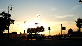 Car city sunset road. Early evening city traffic. Sunrise or sunset in background stock footage