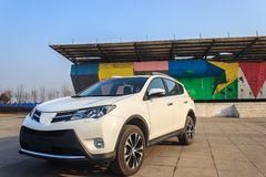 Car at the city. White Toyota suv in haze days features Stock Photography