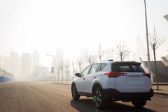 Car at the city. White Toyota suv in haze days features Royalty Free Stock Image