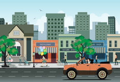 Car in city. Woman driving a 4x4 shop in the city as a backdrop Royalty Free Stock Image