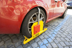 Car clamped on cobbled street Stock Images