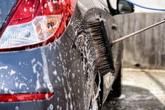 Car at the car wash Royalty Free Stock Photography