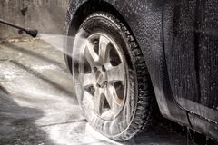 Car at the car wash Royalty Free Stock Image