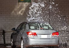 Car cleaning. Employee cleaning a car in a car wash center Royalty Free Stock Photography