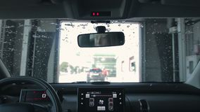 Car Cleaning in automatic Car Wash stock footage
