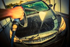 Car Cleaning in a Car Wash. High Pressure Car Washing. Taking Care of a Car Royalty Free Stock Image