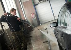 Car cleaning with pressured water. Manual car washing cleaning with foam and water at service station stock images
