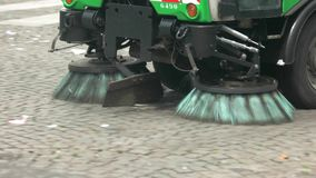 Car is cleaning street. Garbage on road. Keep home town in cleanliness. Work for sake of ecology stock footage