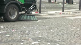 Car is cleaning the street. Trash on road. Make contribution to cleanliness. Don't be a litterbug stock video footage