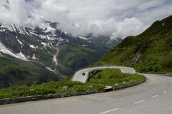 Car climb the alps mountain Stock Image