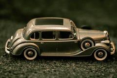 Dark grey vintage car . Retro car`s close up.Retro car on a dark background. Car close-up. stock image