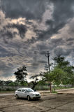 Car with clouds in mid day Royalty Free Stock Image