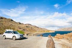 Car on coast of Kleifarvatn lake in Iceland Stock Photos